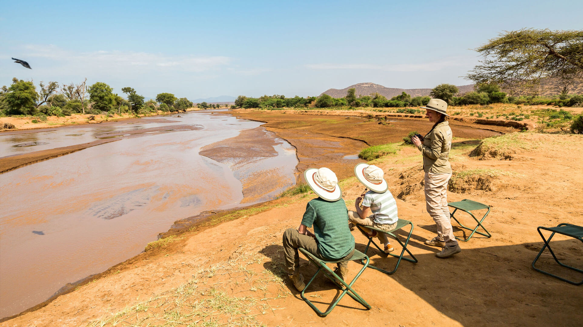 Family safari Africa river