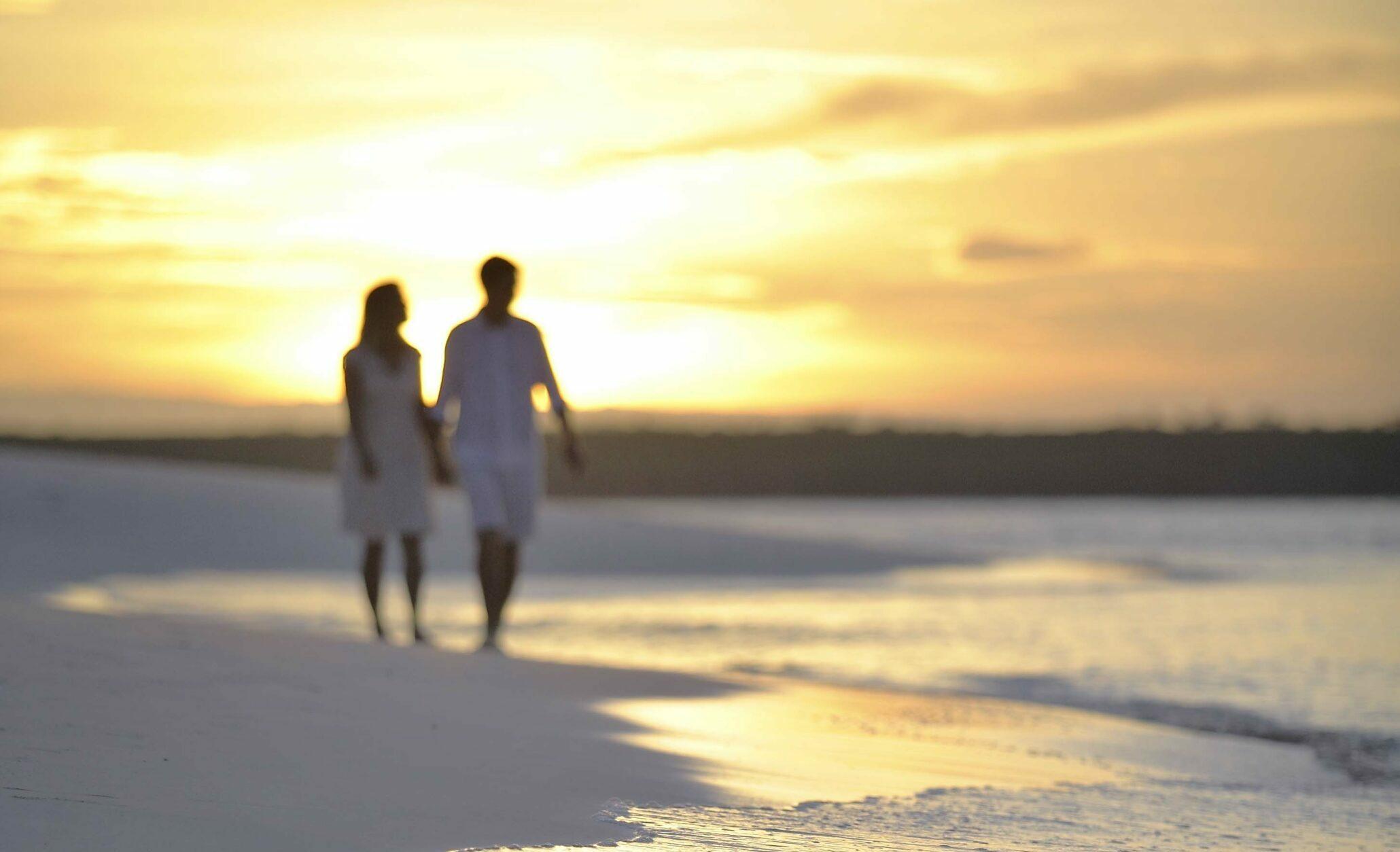 couple walking mnemba island Zanzibar sunset