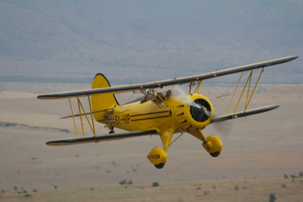 Kenya Lewa Wilderness yellow biplane